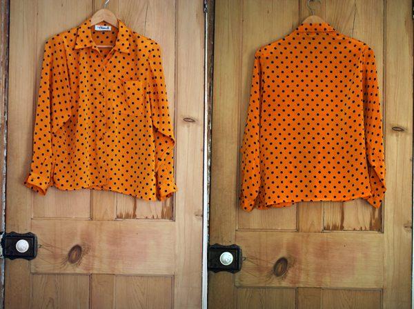 spotty orange blouse