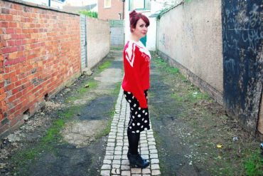 kitsch red jumper and spotty skirt