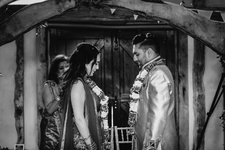 Bride and Groom wearing garlands