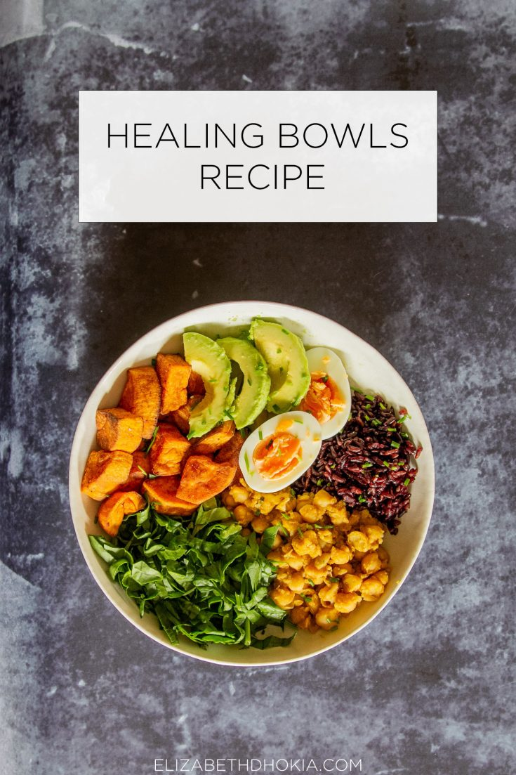 Healing Bowls are a healthy dish of vegetables, grains, proteins and fats. My favourite includes roasted spiced sweet potato, chana (chickpea curry), black rice, shredded spinach, eggs, avocado, tahini dressing, pickled red onion, and garnished with chopped chives.