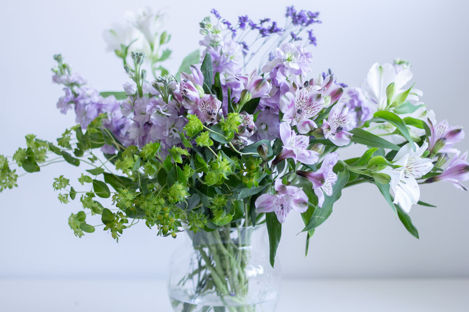 Purple White Green Flowers in Vase
