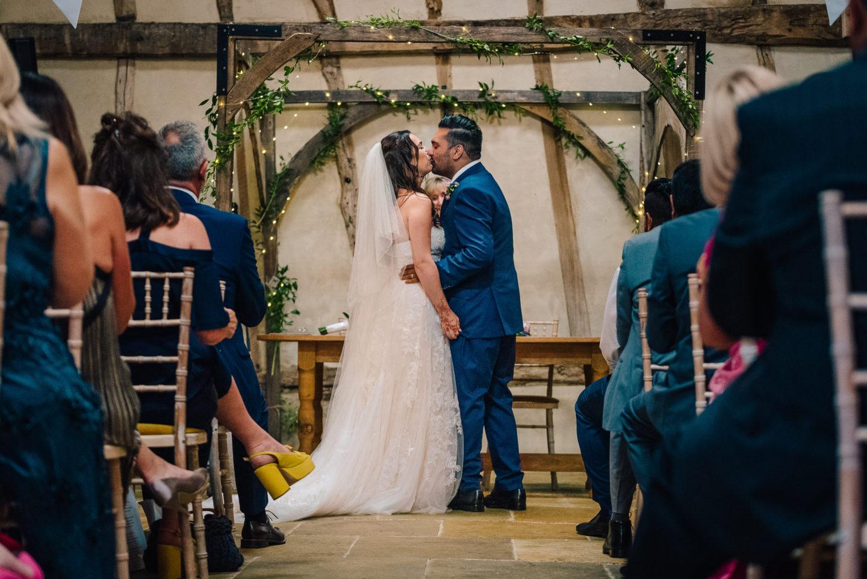 Rustic Barn Wedding Foliage and Fairy Lights
