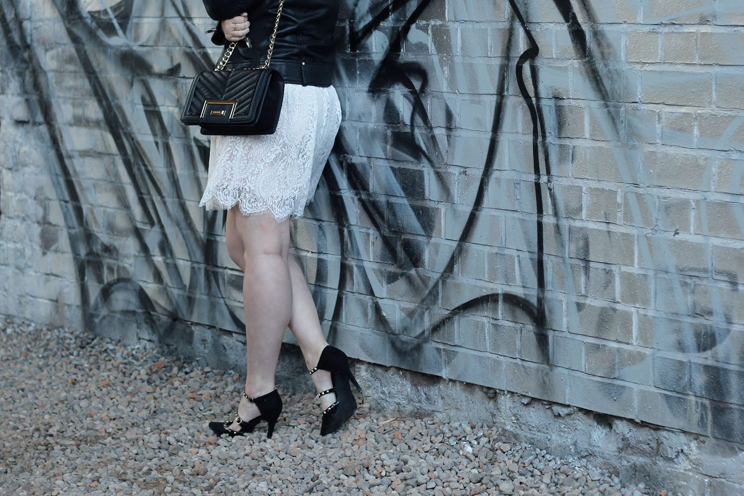 black quilted handbag and studded heels